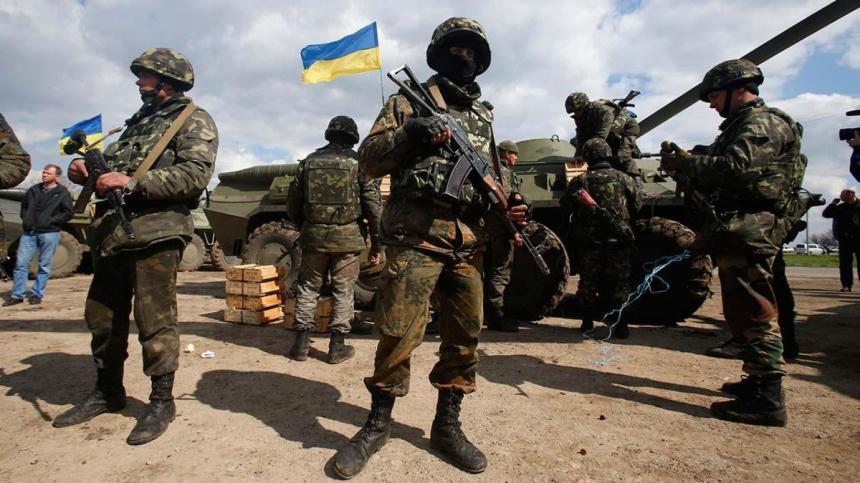 Ukrainian soldiers near an armored car